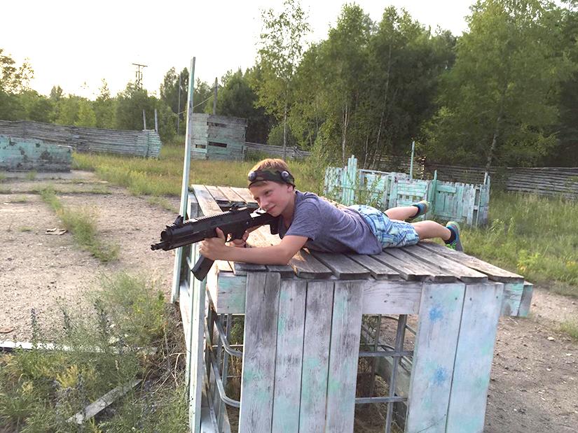 child with a laser tag AK-12LT Predator